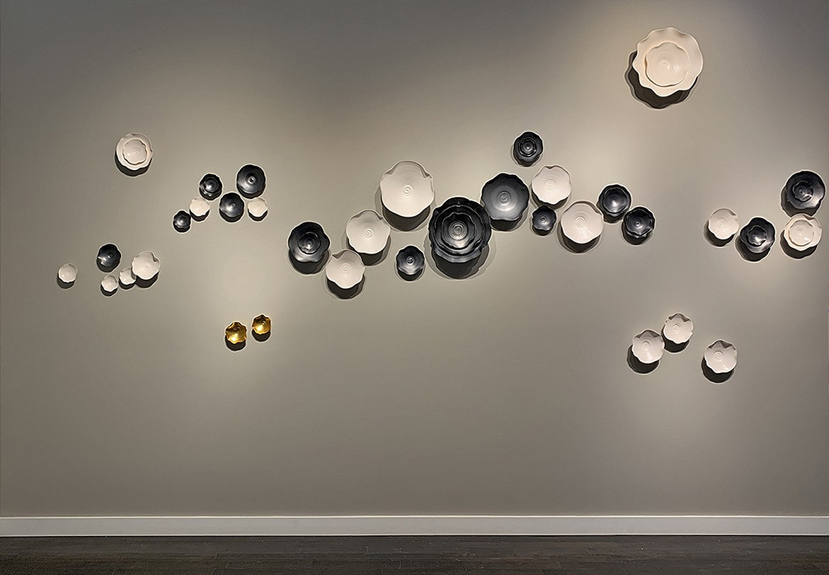 Lucrecia Waggoner, Intertwined I Gunmetal glazed porcelain, natural porcelain and  bronze leaf