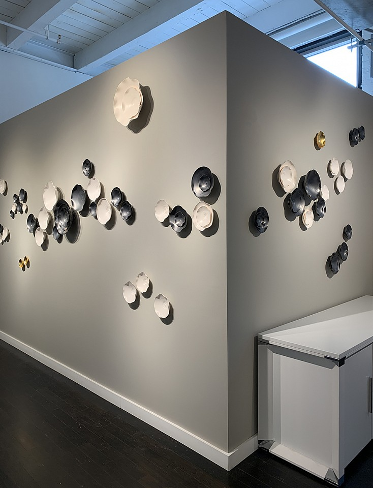 Lucrecia Waggoner, Intertwined I & II Gunmetal glazed porcelain, natural porcelain and  bronze leaf